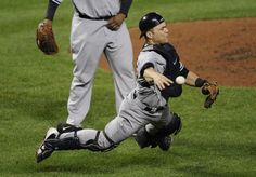 New York Yankees catcher Russell Martin throws out Baltimore Orioles' Lew Ford, not pictured, at first base in the fifth inning of Game 1 of the American League division baseball series on Sunday. [playoffs]