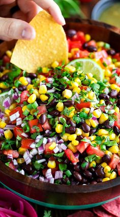food This Black Bean Salsa is perfect as a dip, taco topper, party appetizer, and even as a taco salad mix-in too! We love the simple ingredients and big flavor. Fingerfood Party, Appetizers For Party, Appetizer Recipes, Dinner Recipes, Mexican Food Recipes, Whole Food Recipes, Vegetarian Recipes, Cooking Recipes, Bread Recipes