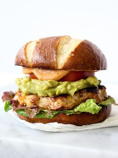 Bacon Cheddar Chicken Burgers with Guacamole and BBQ Mayo | foodiecrush