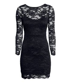 Short, fitted dress in lace with long, sheer sleeves. Lined.