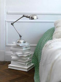 A small table made of books, some glue and paint! Looks so nice - I'll be making one for myself!