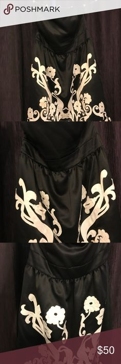 White House Black Market Strapless Dress White House Black Market Strapless Dress size 12 has some spots on the appliques but I am sure if it is given some care it will look good as new! So cute on White House Black Market Dresses Strapless