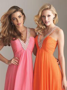 Pink & Orange tropical bridesmaid dresses. Love these Colors.