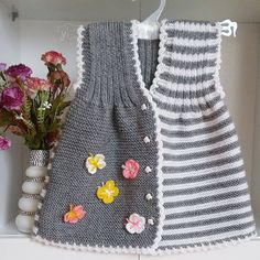 Bilder, Stockfotos und Vektorgrafiken Ornamental Pattern for Knitting and Embroidery Girls Knitted Dress, Knit Baby Dress, Knit Baby Sweaters, Knitted Baby Clothes, Baby Boy Knitting Patterns, Knitting For Kids, Free Knitting, Baby Vest, Baby Cardigan