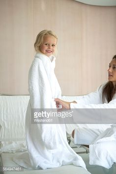 Stock Photo : Mother and daughter relaxing in hotel spa