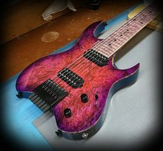 Kiesel Guitars Carvin Guitars V7 (Vader headless Series) Custom color scheme over burl maple top with Kiesel Treated matching board