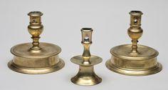 "THREE 17TH CENTURY BRASS CANDLESTICKS  Center: NW Europe, c. 1650. Diminutive brass mid-drip candlestick. 4 3/8"" h."