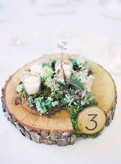 And they look perfectly rustic when you nestle them in a wooden round with some moss and candles.