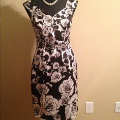 """White House Black Market Dress This will be a staple in your closet. The silky material is classy and very flattering. It is 35 1/2"""" from top to bottom and comes with a matching belt. White House Black Market Dresses Midi"""