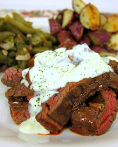 Buffalo Style Skirt Steak with Bleu Cheese Sauce - steak marinated in buffalo sauce and topped with a creamy bleu cheese sauce #MemorialDay #grilling