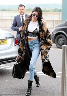 Racy lingerie look: Kendall Jenner flew out of London's Heathrow Airport on Friday morning with her T-shirt worn underneath her bra