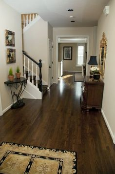 Love the color of these dark wood floors!