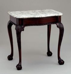"""1760 American (New York?) Table at the Museum of Fine Arts, Boston - From the curators' comments: """"Tables with marble tops served either as pier tables between two windows-often displaying lighting devices or decorations-or as serving tables, where hot or wet dishes could be placed without hurting the table's finish. The small size of this table suggests that it was custom made for a narrow pier."""""""