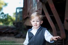 Family photo session! Photographer from Fort Smith Arkansas. Great ideas for family photos and how to dress. Urban theme with trains and train tracks. Love the way the kids are dressed!
