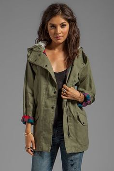 Here's one that's like an anorak/military jacket hybrid and boasts wonderful plaid cuffs.   25 Fall Jackets That Will Make You Wish It Was Cold Already