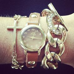 Wrap your wrist in one of our favorite trends: the wrap watch! The Ester Wrap Watch features a polished sideways cross accompanied by a golden chain along the cognac leather band. We also love pairing this trendy style with a classic gold link toggle bracelet!  (W-012211 $34; B-012408 $22)  #justjewelry #jewelry #fashionjewelry #wrapwatch #stackedwrist #armcandy #bracelets #goldjewelry