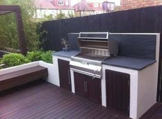 modern garden design with black slate paving, hardwood deck & pergola with floating bench & built in BBQ area. Tall bamboo gives screening & privacy to the boundaries. Deck Pergola, Pergola Ideas, Pergola Kits, Pergola Cover, Deck Landscaping, Modern Pergola, Patio Roof, Pergola Plans, Patio Ideas