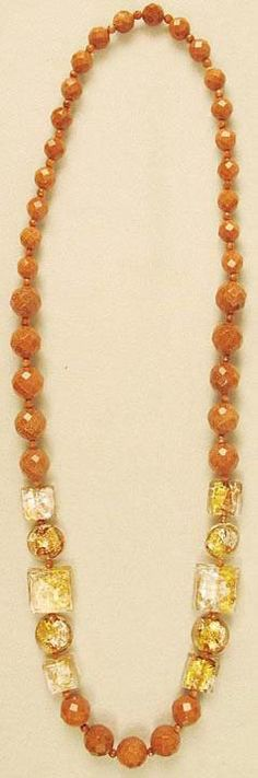 """VENETIAN & GOLDSTONE Goldstone with Venetian accents. These Murano glass beads blaze with gold, copper and silver. Three sizes of goldstone beads. Length: 30"""""""