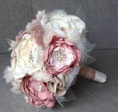 Custom Fabric Flower Bridal Bouquet Dusty Pink, Blush, and Cream.   Vintage Brooches, Rhinestones, Pearls and. $200.00, via Etsy.