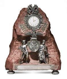 A FABERGÉ SILVER AND HARDSTONE FIGURAL CLOCK, WORKMASTER JULIUS RAPPOPORT, ST PETERSBURG, 1899-1904