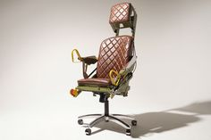 T33 Military Jet Ejection Seat Office Chair - fully repainted and refurbished with luxurious leather. The arm rests can be put in an upright, or downward position. This chair will definitely make a statement in your office!