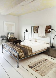 Morten Holtum via Skona Hem {white vintage industrial modern bedroom}, via Flickr.  pipe bed frame. like the headboard being high enough to hang things from