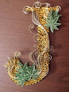 Quilled J - Imgur | Pretty quilling design! I like the long pieces across the foreground, and how the paper for the leaves is crimped but the rest is straight. Cool work.