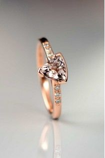 Hand made 9ct rose gold engagement ring. Trillion cut Morganite 0.66ct with round brilliant cut diamonds in the shoulders. From the Slinghshot collection by Scottish designer and goldsmith Christine Sadler Unforgettable Jewellery
