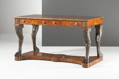 A mahogany writing table, the rectangular top with engraved brass moulding and brass line inlay above a frieze fitted with two drawers, anthemion mounts above the carved naturalistic lion legs with paw feet accentuated at the knees Theodore Alexander, Luxury Furniture Brands, Writing Table, English Heritage, Moulding, Office Desk, Entryway Tables, Drawers, Lion