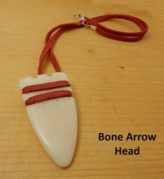 Bone Arrow Head Pendant. Arrow head carved from bone and strung on red leather. Gift for him or her. Birthday gift. Friendship gift. by BettyCampbell on Etsy