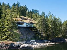 Tula House, Strathcona, Canada - Perched 44 feet above the Pacific Ocean on a remote island, this Canadian house is anchored to the rock by steel rods, which allow the rest of the structure to cantilever above the water. Cantilever Architecture, Interior Architecture, British Columbia, Fran Silvestre, Canadian House, Cliff House, Mansions Homes, Luxury Mansions, México City