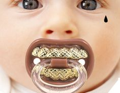 Grillz Pacifier,  Too funny!  Great shower present;)