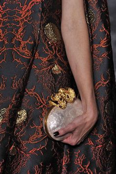 The Valentino fall 2013 haute couture show had us going crazy for clutches— specifically, the gold zodiac-inspired minaudières that were carried down the runway. Take a cue from Paris and tote a compact cutie—whether ornate and extravagant or a simple basic.   - ELLE.com