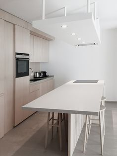 Apartments in Luxembourg by Ardesia Design #interior #design #kitchen #wooden #island #stools