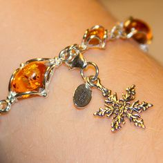 Gorgeous Amber Charm Bracelet with SnowFlake Charm. From Carin Bracelets - A Direct Sales Company
