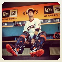 Buster Posey of the #Giants gets ready in the dugout before the game against the #Dodgers in #SanFrancisco. (By @bmangin / SI) #MLB