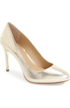 These pale gold pumps will be an essential during holiday season. A graceful almond toe and logo-etched hardware make these beauties standout.