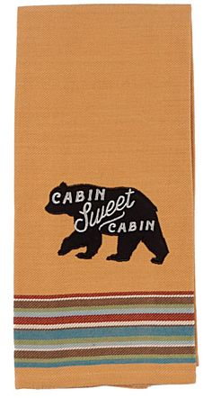 """Perfect for those who love the wilderness and great outdoors, the golden Lake Lodge Bear Tea Towel features an applique bear and embroidered wording in white """"Cabin Sweet Cabin"""". - 100% cotton - Machi"""