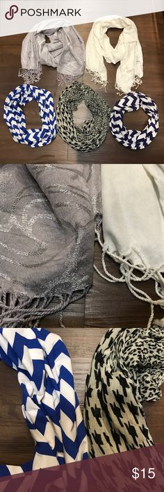Scarf Lot 5 total scarves. 2 scarves with tassel endings. One is cream and the other is a gray metallic design. 3 circle scarves. Two chevron scarves have never been worn. One is navy blue and white, the other is royal blue and white. Other circle scarf is half leopard print and half houndstooth. Please ask if you have questions! Accessories Scarves & Wraps