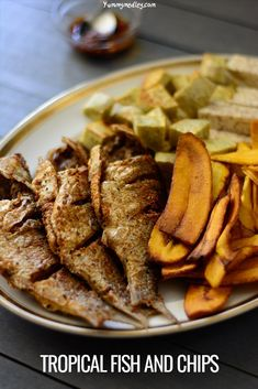 n this alternative tropical fish & chips recipe, I serve freshly caught fried perch with fried sweet potato cubes, fried taro root, and some plantain chips. Fried Fish Recipes, Seafood Recipes, Dinner Recipes, Seafood Diet, Fish Dishes, Spicy Dishes, West African Food, Nigerian Food, Black Food