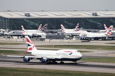 A British Airways 747 takes off from London Heathrow with Terminal 5 in the background.
