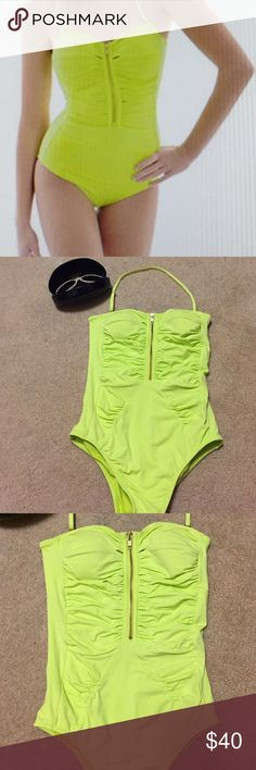 Swimsuit Have fun in the sun in this bright lemon lime citrus bandeau bathing suit. It is runched with small peek-a-boo cut outs down the zipper. convertible halter strap. Size small.bust 32/hips 35. Very flattering fit! R Collection Swim One Pieces