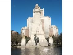 Plaza de España with bronze statues of Don Quixote and Sancho Panza, and a stone statue of Miguel de Cervantes ( Spanish novelist, poet and playwright ). The monument is surrounded by the Torre de Madrid and the Edificio España.