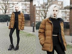 Camel brown puffer jacket over head-to-toe black