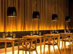 """""""#Black and #gold"""", inspiration by #Prandina. A combination of indirect and downward #lighting that makes the #wooden elements shine like gold, creating interesting reflections on the shiny black #lamps. A #restaurant filled with light yet maintaining a very intimate atmosphere. Discover more on design2taste.com"""