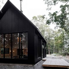 The Grand Pic Cottage is a minimalist's dream come true. Located in Quebec, the structure of the home is built from black corrugated steel. The interior of the home sees plywood lined walls and complimented with black and white appliances/furniture. The bedrooms are located above the kitchen. Photos: Félix Michaud/Appareil Architecture  via ✨ @padgram ✨(http://dl.padgram.com) #MinimalistHomeAppliances