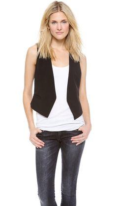 black vest, white tank, dark skinny jeans and tennies