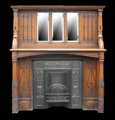 I like the arrow design in the breast of the fireplace.  Arts & Crafts antique oak fireplace