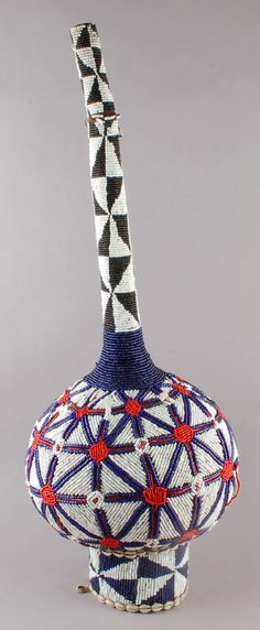 Africa | Vessel made by the Ibibio people of Southern Nigeria or Cameroon | Gourd covered in sacking cloth and decorated with glass beads and cowrie shells | ca. 1978 or earlier