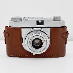 Vintage. Looks like an old Leica camera.  |Pinned from PinTo for iPad|
